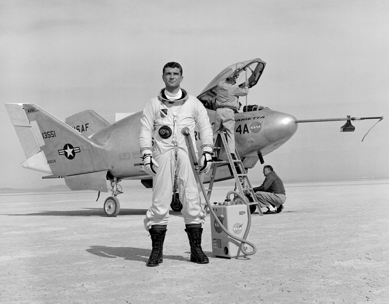Air Force pilot Major Cecil Powell stands in front of the X-24A after a research flight. Built for the Air Force by Martin Marietta, the X-24A was a bulbous vehicle shaped like a tear drop, with three vertical fins at the rear for directional control. It weighed 6,270 pounds, was just over 24 feet long, and had a width of nearly 14 feet. The first unpowered glide flight of the X-24A was on April 17, 1969. The pilot was Air Force Major Jerauld Gentry. Gentry also piloted the vehicle on its first powered flight March 19, 1970. It was flown 28 times in a program which, like the HL-10, helped validate the concept that a space shuttle vehicle could be landed unpowered. Fastest speed in the X-24A was l,036 mph (Mach 1.6). The pilot was John Manke, who also reached the highest altitude in the vehicle, 71,400 feet. He was also the pilot on its final flight June 4, 1971. The X-24A was later modified with a different nose configuration and became the X-24B.