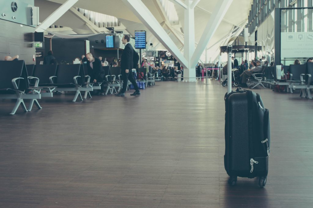 travel-policy-issues-airport-suitcase